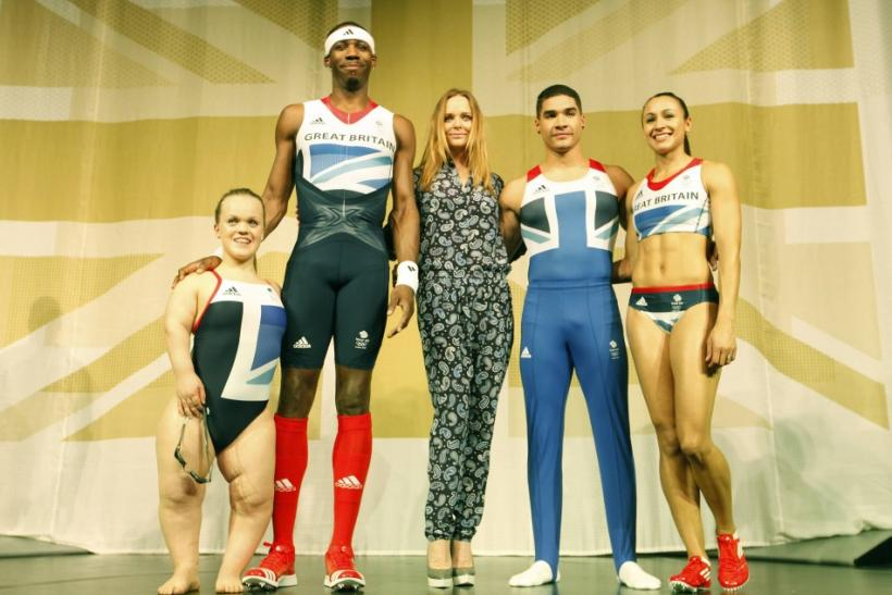 Eleaonor Simmonds (L-R), triple jumper Phillips Idowu, gymnast Louis Smith and heptathlete Jessica Ennis pose wearing the new Team GB kits designed by British designer Stella McCartney (C) for the London 2012 Olympic Games, at a media viewing in London Ma