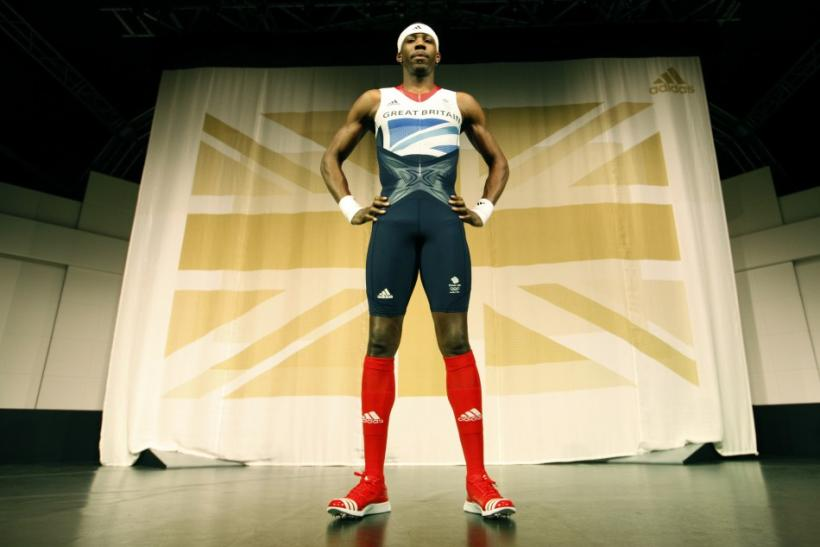 Triple jumper Phillips Idowu poses wearing the new Team GB kits designed by British designer Stella McCartney for the London 2012 Olympic Games, at a media viewing in London March 22, 2012