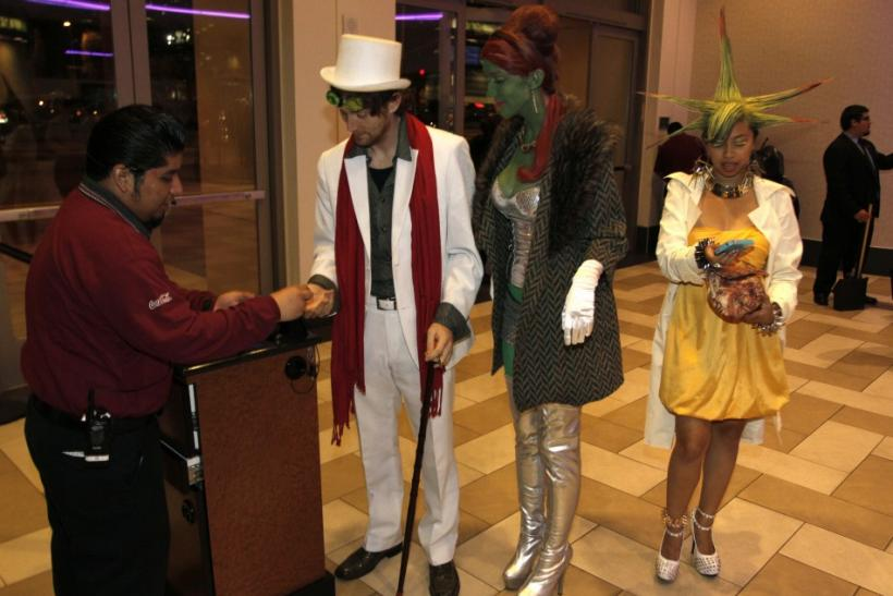"Movie attendees dressed as characters in ""The Hunger Games"" arrive for the midnight screening on opening night at Regal Cinemas in Los Angeles, California March 22, 2012."
