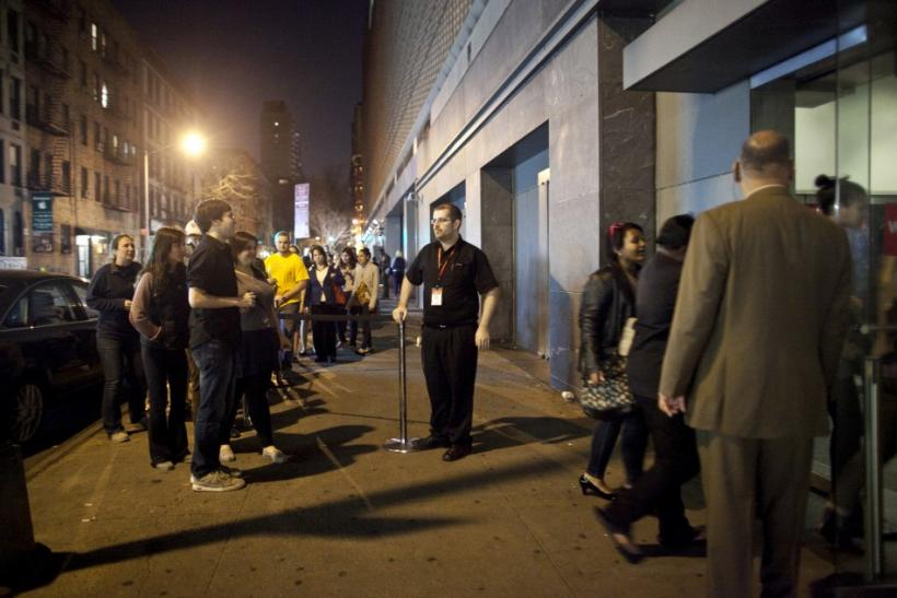 "Fans line up to see the midnight shows of ""The Hunger Games"" at the AMC Loews Lincoln Square Theatre in New York March 22, 2012. The film is based on the popular young adult book series by Suzanne Collins."