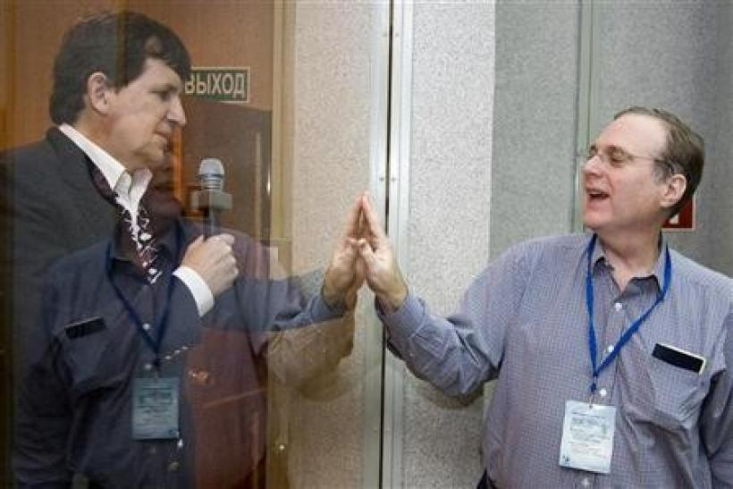 U.S. entrepreneur Charles Simonyi (L) meets his friend, Microsoft co-founder Paul Allen at the Baikonur cosmodrome March 25, 2009.
