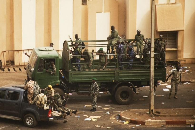 Malian soldiers and security forces gather at the offices of the state radio and television broadcaster after announcing a coup d'etat in the capital Bamako