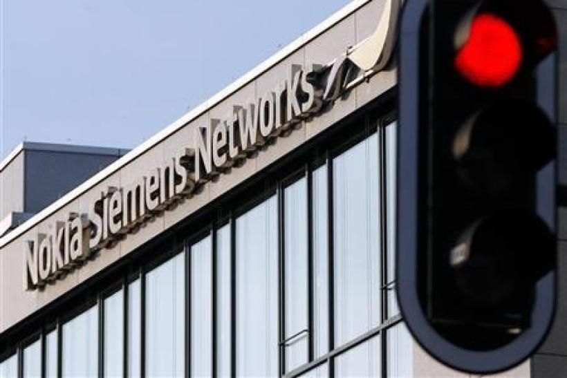 A red traffic light is seen next to the German headquarters of Nokia Siemens Networks in Munich January 31, 2012.