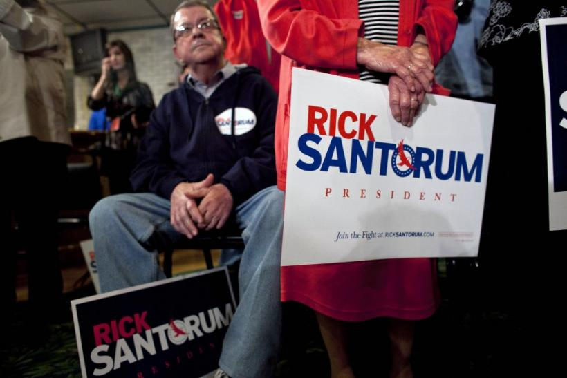Supporters listen to Republican presidential candidate and former U.S. Senator Rick Santorum as he addresses supporters at a rally in Sheboygan, Wisconsin March 24, 2012