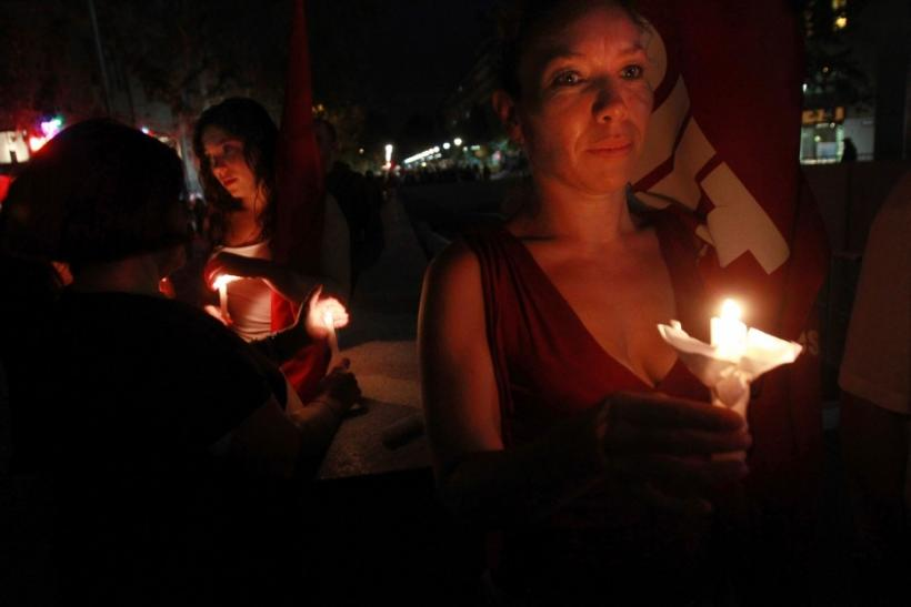 Residents and victims of the February 2010 magnitude 8.8 earthquake and ensuing tsunamis light candles as they gather in commemoration of the victims, in Santiago February 27, 2012.
