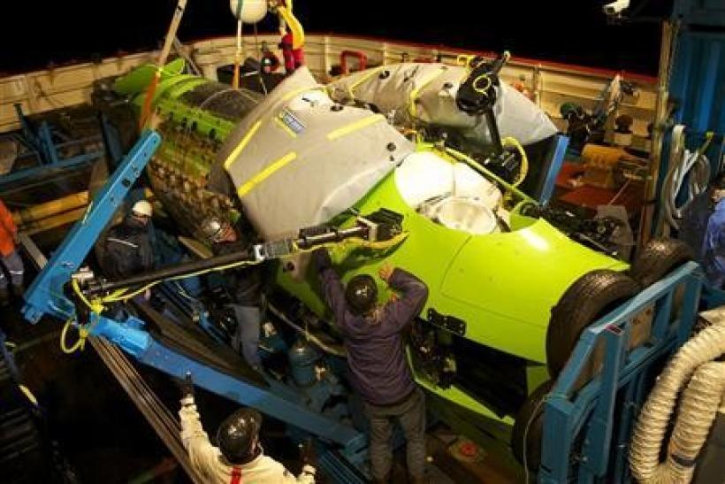 Crews prepare the Deepsea Challenger for its first test in the ocean at Jervis Bay, south of Sydney