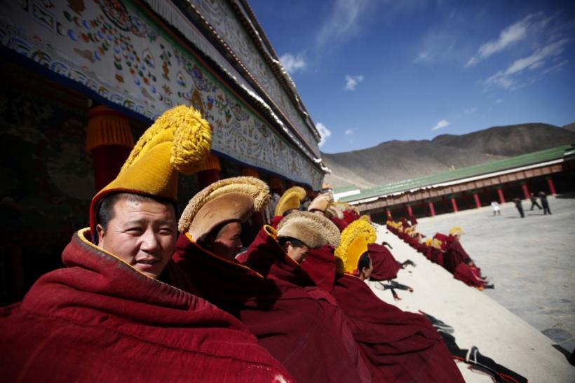 Photo above shows Tibetan monks praying in Gansu Province, China on February 21, 2012