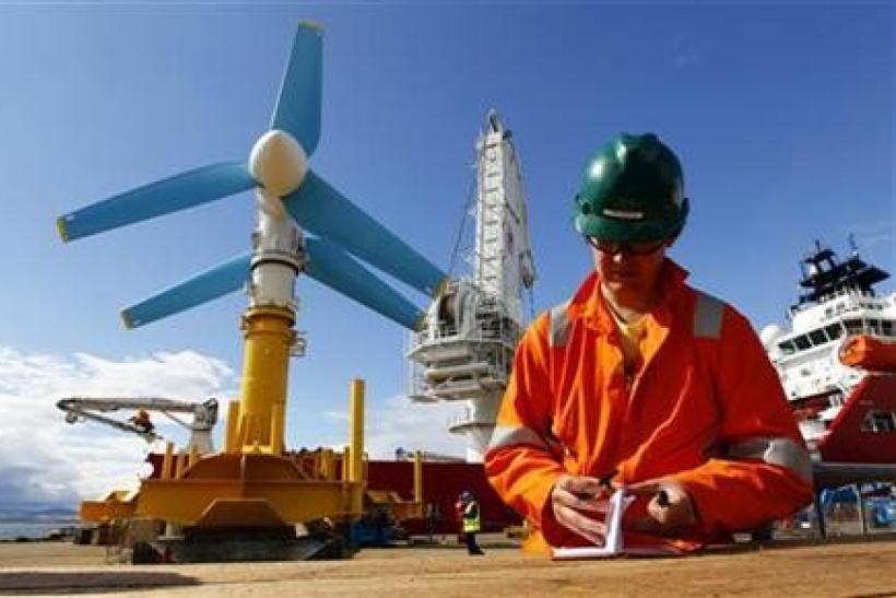 An engineer works near the Atlantis Resources AK-1000 tidal energy turbine before it is shipped to the European Marine Energy Centre test site in the Orkney Islands from the port at Invergordon, northern Scotland August 12, 2010.