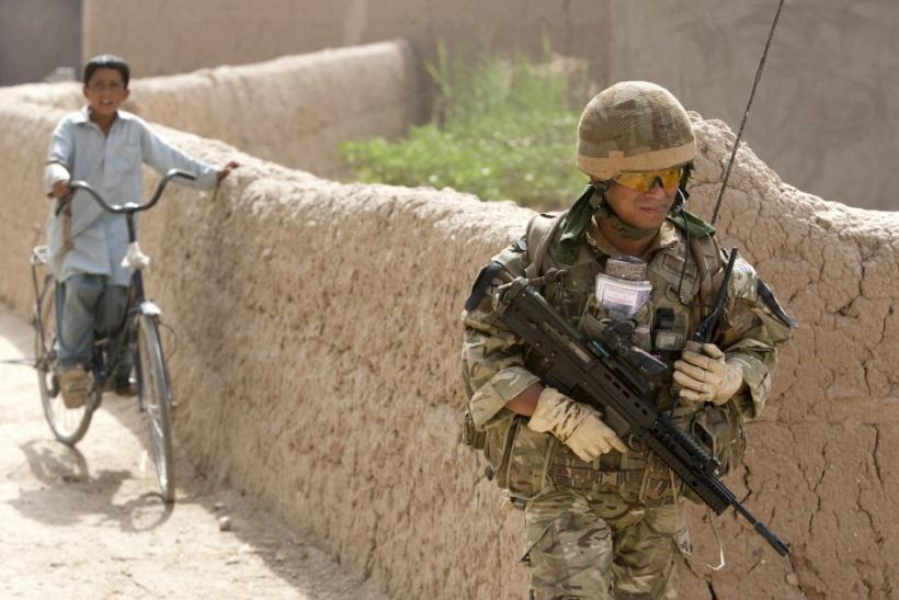 British soldier on patrol outside military base near Lashkar Gah in southern Afghanistan