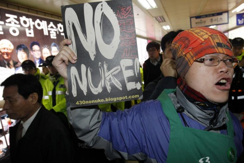 An anti-nuclear activist shouts slogans during a protest in Seoul