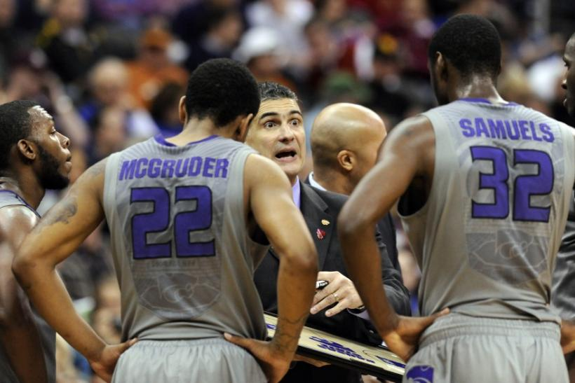 Kansas State Wildcats head coach Martin talks with his team during the quarterfinals of the NCAA Men's Big 12 basketball championship in Kansas City