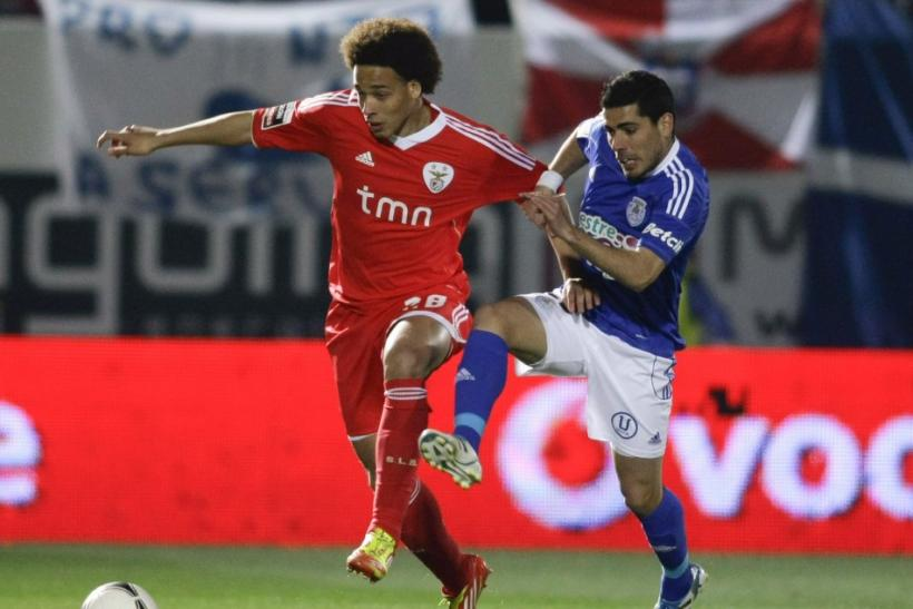 Manchester United are reportedly interested in Benfica midfielder Axel Witsel (L)