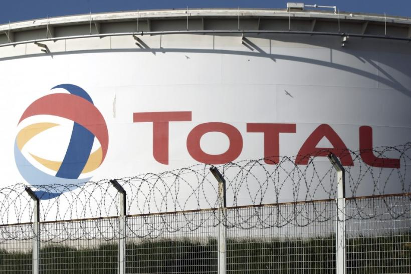 Qatar Investment Fund hikes its stake in French oil and gas giant Total SA.
