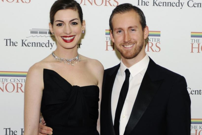 "The bride-to-be and ""Dark Knight Rises"" actress celebrated her engagement Adam Shulman at a New York City bookstore with a couple of quirky details."
