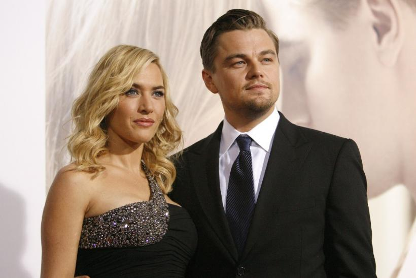 "Cast member Kate Winslet poses with co-star Leonardo DiCaprio at the premiere of the movie ""Revolutionary Road"" at the Mann Village theatre in Westwood, California December 15, 2008."
