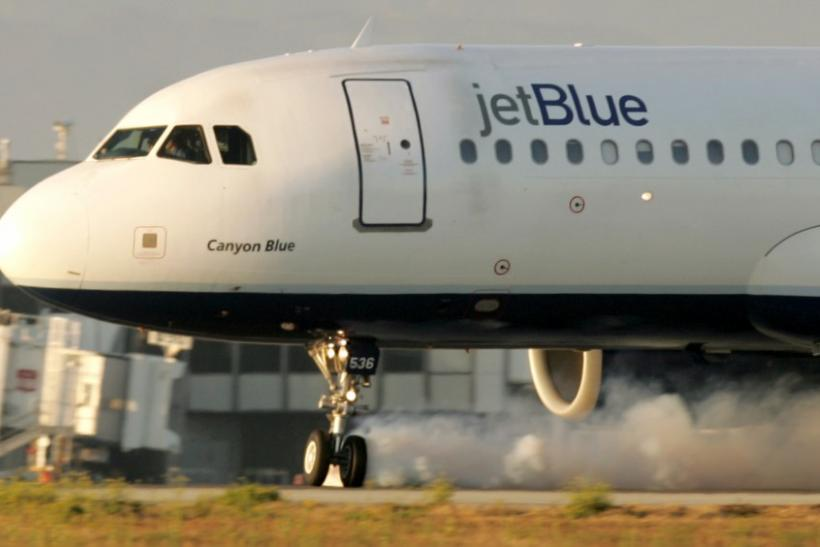 File photo of a JetBlue Airbus at Los Angeles International Airport with landing gear turned sideways