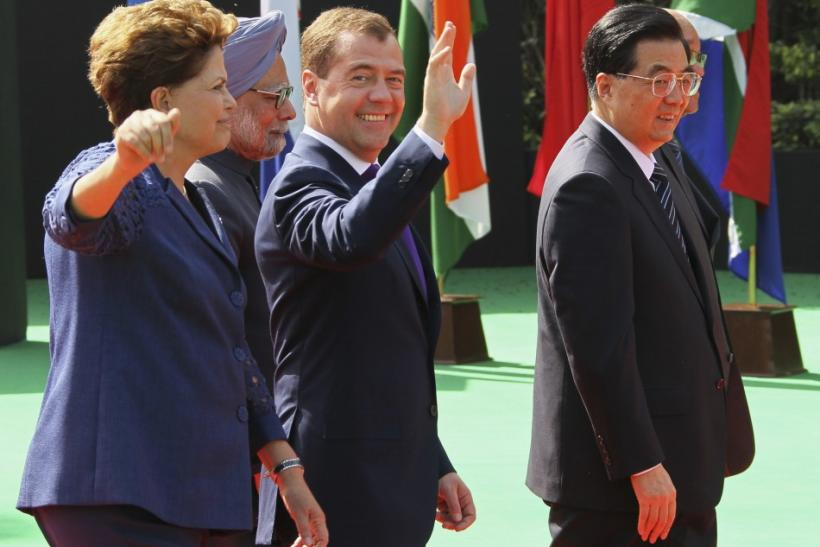 World leaders wave during a group photograph during the BRICS summit in New Delhi