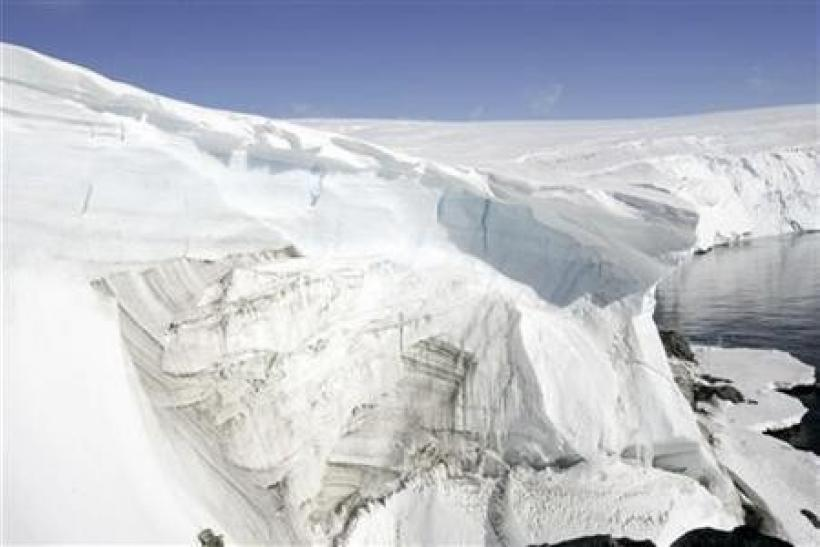 Ice melt shows through at a cliff face at Landsend on the coast of Cape Denison in Antarctica December 14, 2009.