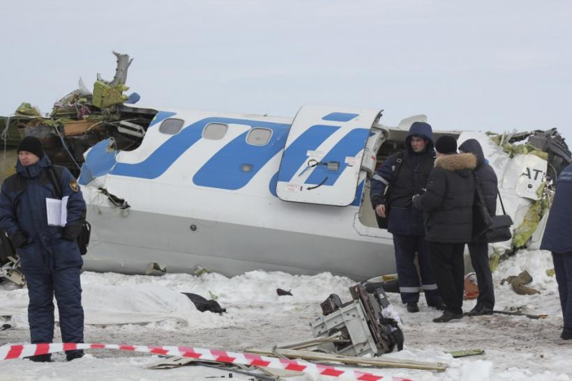 Emergency service workers investigate the wreckage of the UTair airlines ATR 72 passenger plane that crashed near the Siberian city of Tyumen 02/04/2012