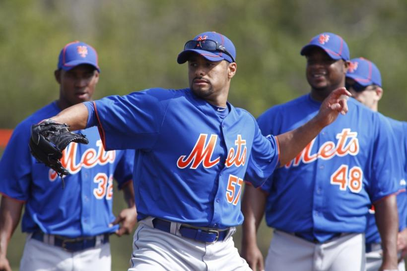 Mets opening day starter Johan Santana simulates a throw during a spring training workout.