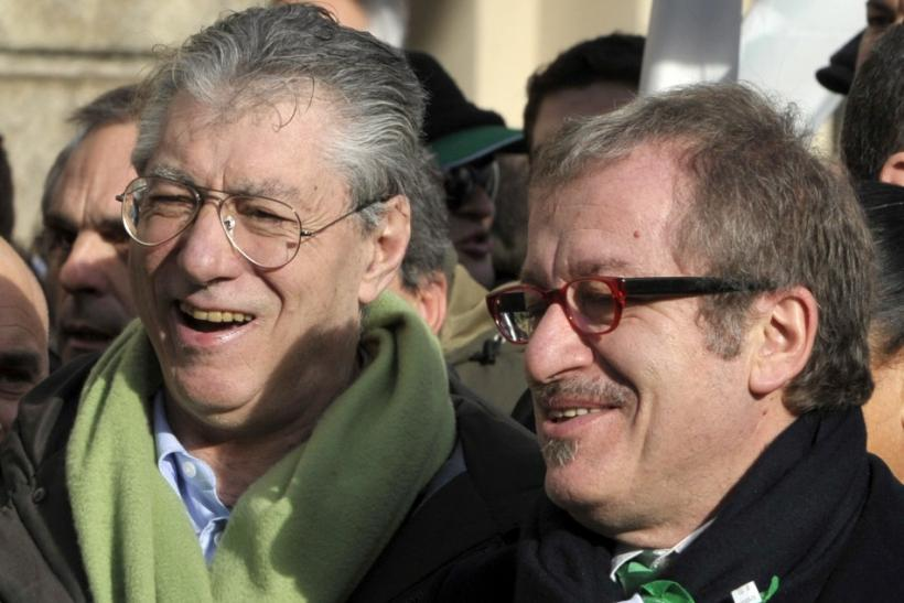 Northern League leader Umberto Bossi and Roberto Maroni attend a rally against the government in Milan
