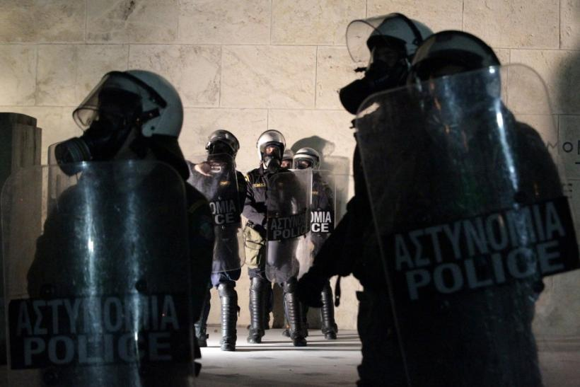 Policemen stand guard during a rally in front of the parliament in Athens