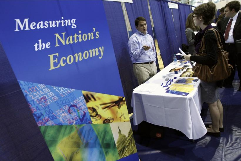 American University student Caitlin Treanor (R) speaks with job recruiter Jon Avery during a career job fair at American University in Washington March 28, 2012.
