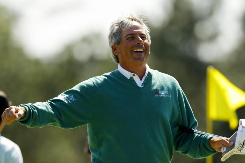 Fred Couples shares the Masters lead with Jason Dufner, while Tiger Woods falters and Rory Mcllroy puts himself in contention on day two at Augusta.