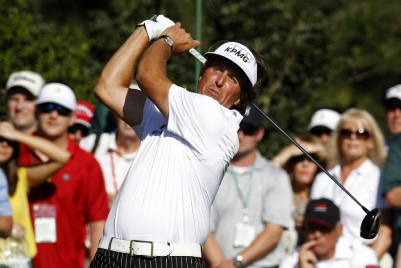Phil Mickelson of the U.S. hits his tee shot on the 15th hole during third round play in the 2012 Masters Golf Tournament at the Augusta National Golf Club in Augusta, Georgia, April 7, 2012.