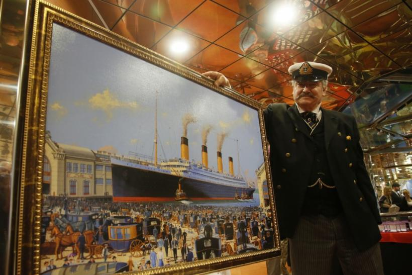 Maritime artist Flood of Del Ray Beach, Florida poses with his painting of the doomed Titanic liner on board the Titanic Memorial Cruise off Cobh