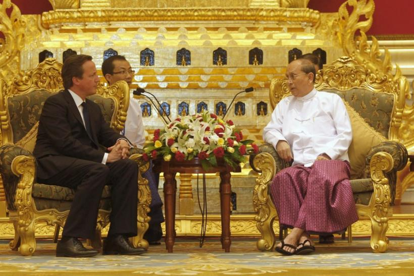 British Prime Minister David Cameron (L) listens to Myanmar's President Thein Sein during their meeting at the President's Office in Naypyitaw April 13, 2012.