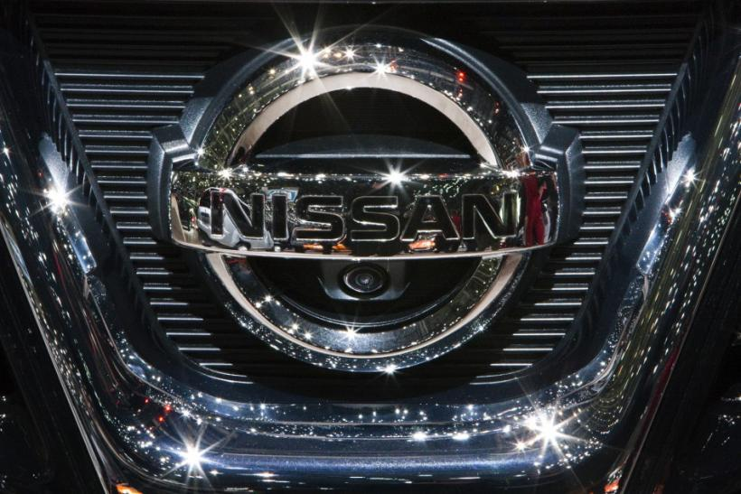 The Nissan logo on a car.