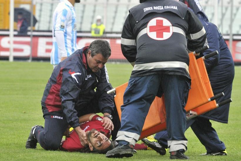 Emergency workers attempt to help Piermario Morosini after he collapsed during a Serie B game.