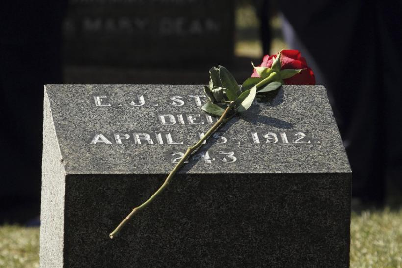 A flower rests on a grave marker of a Titanic victim during the 100th anniversary memorial service at he Fairview Lawn Cemetery