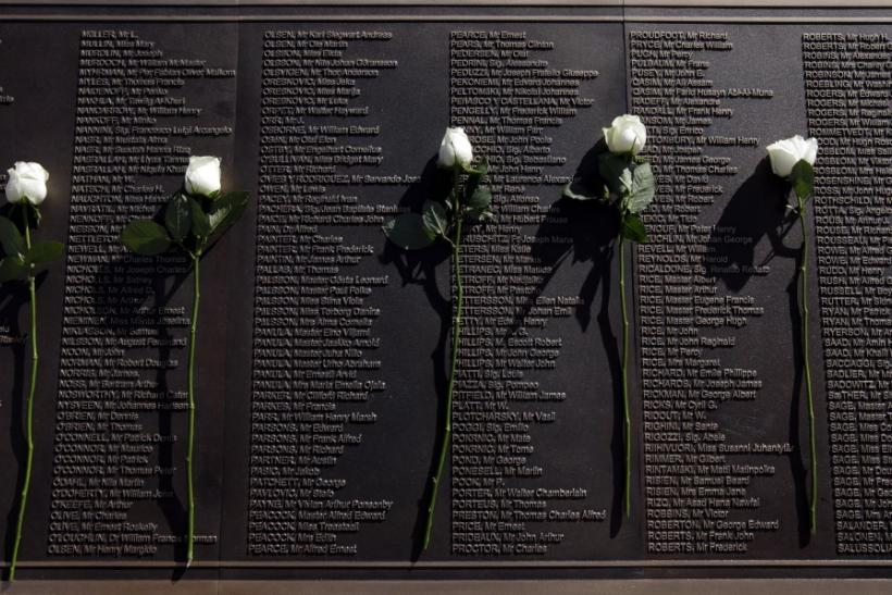 Roses rest on a plaque bearing the names of those who died when the Titanic sank, at the unveiling of the Titanic Memorial Garden in Belfast