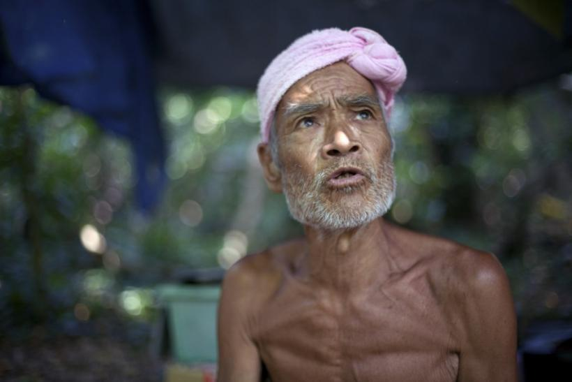 Seventy-six-year-old naked hermit Nagasaki speaks on Sotobanari island, Okinawa prefecture, Japan