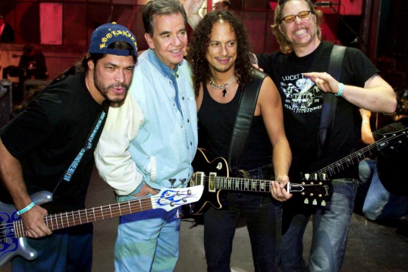 Metallica bassist Robert Trujillo, Dick Clark, Metallica guitarist Kirk Hammett and singer/guitarist James Hetfield, pose while the rock band rehearses for the 31st annual American Music Awards at the Shrine Auditorium in Los Angeles, California, November