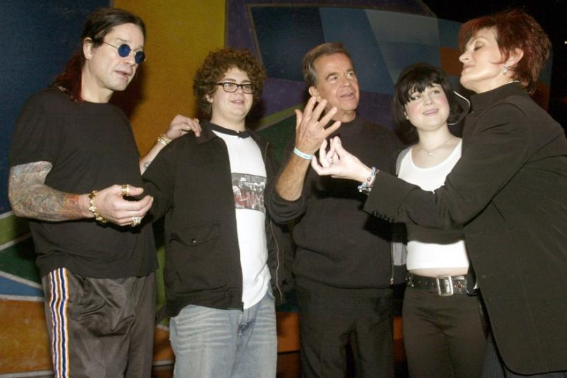 Sharon Osbournes jokes around with Dick Clark as (L to R) husband Ozzy Osbourne, son Jack and daughter Kelly look on before rehearsing on January 11, 2003 for the upcoming American Music Awards in Los Angeles.