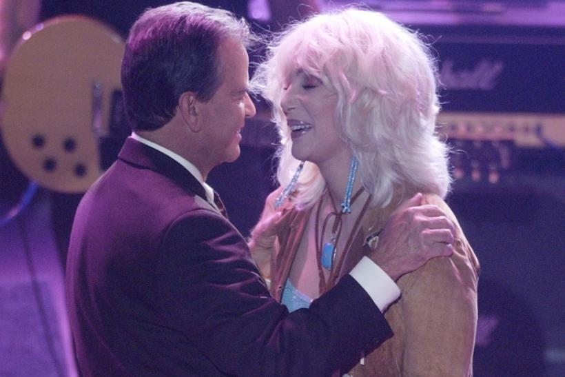 "Host Dick Clark (L) thanks singer Cher for her performance at a taping of ""American Bandstand's 50th...A Celebration"" in Pasadena, California, April 20, 2002."