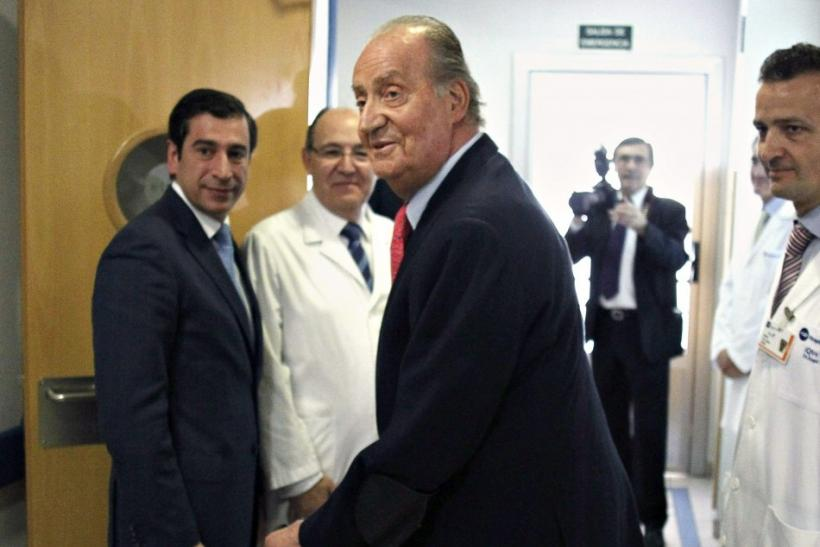 Spain's King Juan Carlos leaves the hospital after being discharged in Madrid