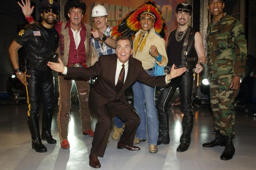 "Host Dick Clark (C), poses for photographers with members of the Village People before the Disco group performed a medley of their hit songs during a taping of ""American Bandstand's 50th...A Celebration"" in Pasadena, California, April 20, 2002."
