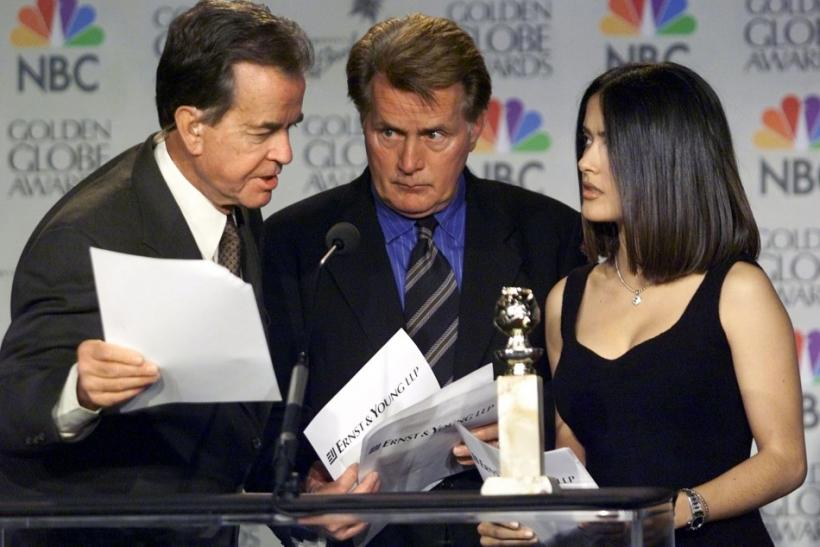 Actor Martin Sheen (C) reacts as producer Dick Clark (L) corrects a mistake Sheen made during the announcement ceremonies for the 57th Annual Golden Globe Awards December 20 in Beverly Hills, California. Actress Salma Hayek shares the podium with the men.