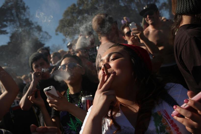 People smoke marijuana joints at 4:20 p.m. as thousands of marijuana advocates gathered at Golden Gate Park in San Francisco
