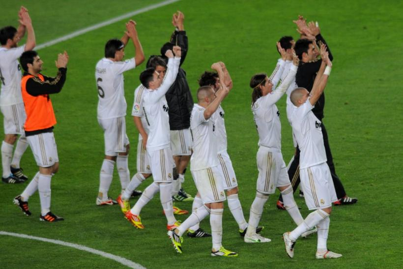 "Real Madrid's players celebrate victory over Barcelona at the end of their Spanish first division ""El Clasico"" soccer match"
