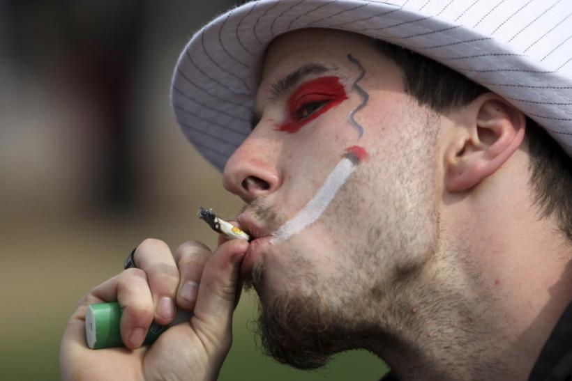 A man smokes marijuana during a 4/20 rally to demand the legalization of marijuana on Parliament Hill in Ottawa