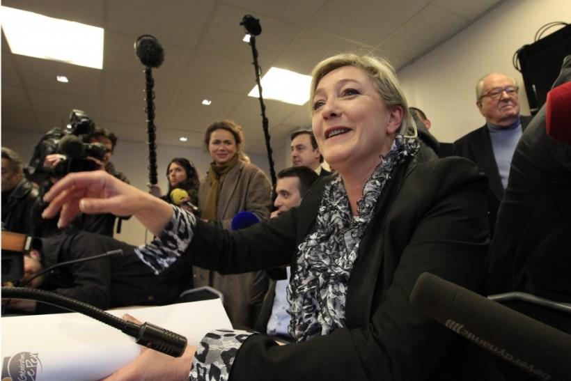 France's far right National Front party leader Marine Le Pen attends a meeting at the party's headquarters in Nanterre, near Paris