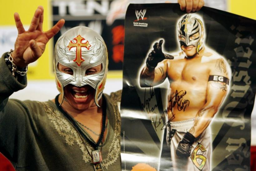 World Wrestling entertainer Rey Mysterio from the U.S. waves during a function in Mumbai