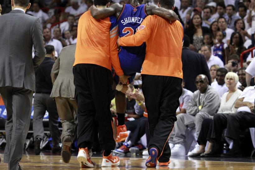 Knicks' guard Iman Shumpert is carried off the floor after tearing his ACL.