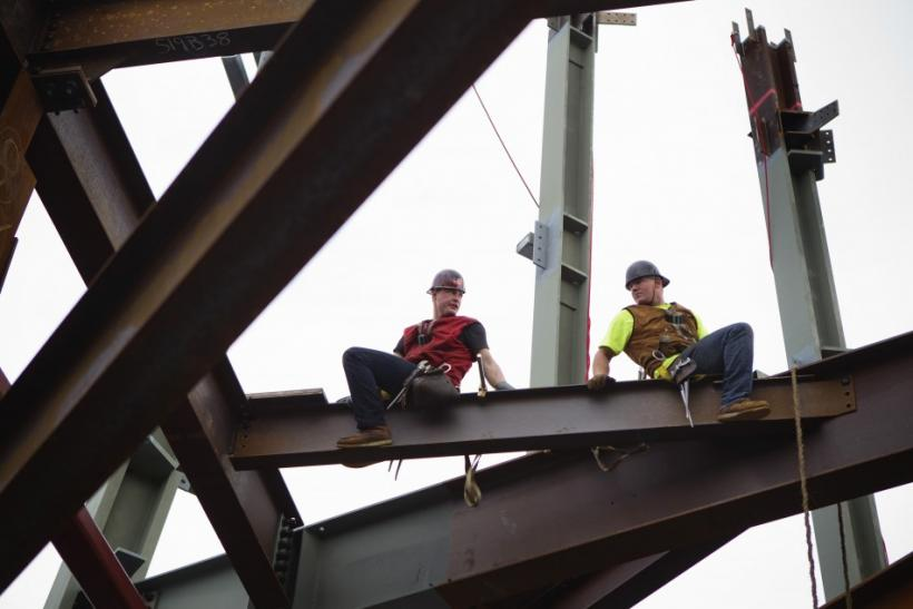 Ironworkers work while balancing on support beams above the 93rd floor of One World Trade Center as the building nears 100 stories tall in New York