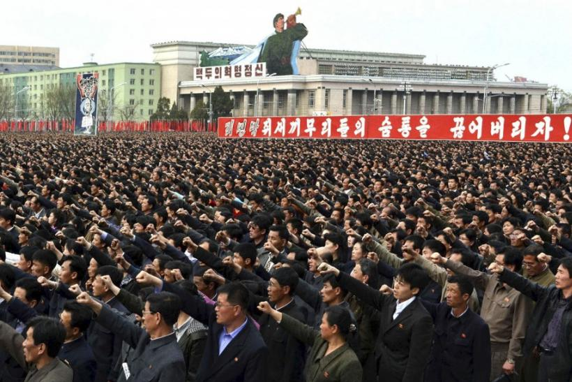 North Korean people and soldiers attend a rally denouncing South Korean President Lee Myung-bak at the Kim Il Sung Square in Pyongyang